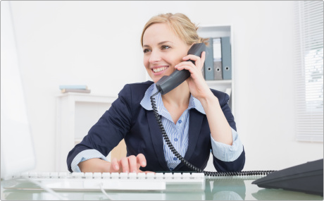 Women Using a Polycom Business Phone